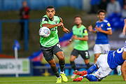 AFC Wimbledon forward Kwesi Appiah (9) goes past Ipswich Town defender James Wilson (5) during the EFL Sky Bet League 1 match between Ipswich Town and AFC Wimbledon at Portman Road, Ipswich, England on 20 August 2019.