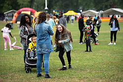 © Licensed to London News Pictures . 12/08/2018. Manchester , UK . ELLIE LAWRENCE (11 from Nottingham) dances in the field . The second day of the annual Caribbean Carnival in Alexandra Park in Moss Side , celebrating music , food and Afro-Caribbean culture . A nearby shooting overnight lead to at least ten people injured . Ten people are in hospital . Photo credit : Joel Goodman/LNP