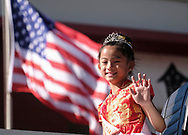 A young parade participant waves with people during the 119th annual Chinese New Year &quot;Golden Dragon Parade&quot; in the streets of Chinatown in Los Angeles, the United States, Saturday Feburary 17, 2018. (Xinhua/Zhao Hanrong)<br /> 2月17日,在美国洛杉矶,一名游行队成员向人们挥手。当日,第119届金龙大游行在洛杉矶举行,庆祝中国农历新年。 (Photo by Ringo Chiu)<br /> <br /> Usage Notes: This content is intended for editorial use only. For other uses, additional clearances may be required.