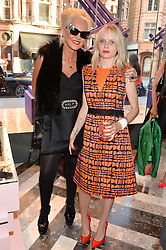 Left to right, AMANDA ELIASCH and SCARLETT CARLOS CLARK at the opening of Roksanda - the new Mayfair Store for designer Roksanda Ilincic at 9 Mount Street, London on 10th June 2014.
