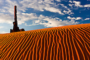 Sidelight enhances the striking dune patterns near the Totem Pole, in Monument Valley Navajo Tribal Park