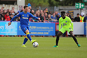 AFC Wimbledon midfielder Dannie Bulman (4) controlling the ball during the EFL Sky Bet League 1 match between AFC Wimbledon and Peterborough United at the Cherry Red Records Stadium, Kingston, England on 17 April 2017. Photo by Matthew Redman.