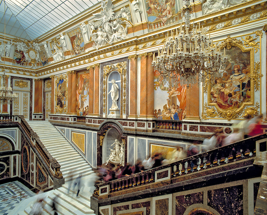Visitors fill the marble stairways in the Gallery at Herrenchiemsee Castle in Bavaria, Germany.