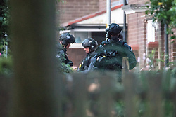 © Licensed to London News Pictures . 26/07/2017 . Oldham , UK . Armed police at the front of the house after blowing through the front door to end the siege in the early hours of the morning . Scene of an armed siege that began at 3.15am on Tuesday 25th July in a house on Pemberton Way in Shaw , is ongoing in to a second night . A man named locally as Marc Schofield is reported to be holding a woman hostage after earlier releasing two children . The gas supply in the area has been cut off and several neighbouring properties have been evacuated . Photo credit : Joel Goodman/LNP
