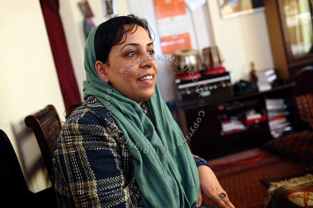 Roya Sadat, 28, a documentary and fiction filmmaker, is sitting in her home in Kabul, Afghanistan. Roya's most famous production is titled 'Three Dots', an award-winning film that tells the story of women's village life in the province of Herat, western Afghanistan.
