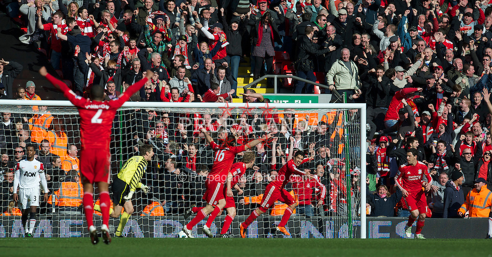 LIVERPOOL, ENGLAND - Sunday, March 6, 2011: Liverpool's Luis Alberto Suarez Diaz celebrates after setting up Dirk Kuyt for his side's first goal during the Premiership match at Anfield. (Photo by David Rawcliffe/Propaganda)