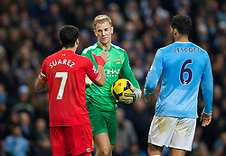 MANCHESTER, ENGLAND - Boxing Day Thursday, December 26, 2013: Liverpool's captain Luis Suarez in action against Manchester City's goalkeeper Joe Hart during the Premiership match at the City of Manchester Stadium. (Pic by David Rawcliffe/Propaganda)