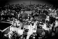 """Looking out over Kabuki Cho, Tokyo's largest red light district, where there are also many 24 hour """"mangakissa"""" internet comic cafes where young homeless often sleep to stay off the streets at night, Japan."""