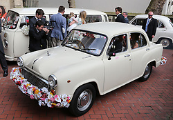 Indian style cars take guests away from Poppy Delevigne's wedding at St.Paul's Church in Knightsbridge, London , Friday, 16th May 2014. Picture by Stephen Lock / i-Images