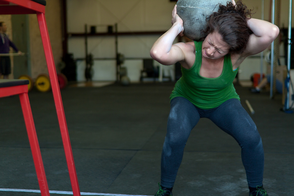 Venassa Sandoval kicking ass with a 70lbs Atlas Stone, Crossfit image, picture, photo, photography of health, elite, exercise, training, workouts, WODs, taken at Progressive Fitness CrossFit,Colorado Springs, Colorado, USA