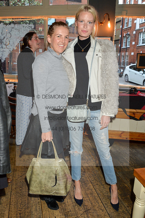 Left to right, HANNELI RUPERT and CAROLINE WINBERG at a quiz night hosted by Zoe Jordan to celebrate the launch of her men's ZJKNITLAB collection held at The Larrick Pub, 32 Crawford Place, London on 20th April 2016.