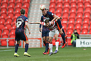 Blackpool defender Tom Aldred (15)  beats Doncaster Rovers forward Andy Williams (11)  in the air during the Sky Bet League 1 match between Doncaster Rovers and Blackpool at the Keepmoat Stadium, Doncaster, England on 28 March 2016. Photo by Simon Davies.