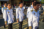 """04 FEBRUARY 2013 - PHNOM PENH, CAMBODIA: Cambodian government officials in their mourning uniforms walk into the National Museum for the  cremation of King-Father Norodom Sihanouk in Phnom Penh. Norodom Sihanouk (31 October 1922- 15 October 2012) was the King of Cambodia from 1941 to 1955 and again from 1993 to 2004. He was the effective ruler of Cambodia from 1953 to 1970. After his second abdication in 2004, he was given the honorific of """"The King-Father of Cambodia."""" Sihanouk died in Beijing, China, where he was receiving medical care, on Oct. 15, 2012.    PHOTO BY JACK KURTZ"""