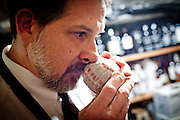 Rick Mindermann smells Chinese tea dating from 1930 at Corti Bros. in Sacramento, Calif., March 3, 2012.