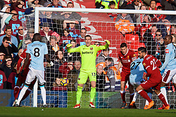 LIVERPOOL, ENGLAND - Saturday, February 24, 2018: West Ham United's goalkeeper Adrian San Miguel del Castillo reacts as Liverpool's Emre Can scores the first goal during the FA Premier League match between Liverpool FC and West Ham United FC at Anfield. (Pic by David Rawcliffe/Propaganda)