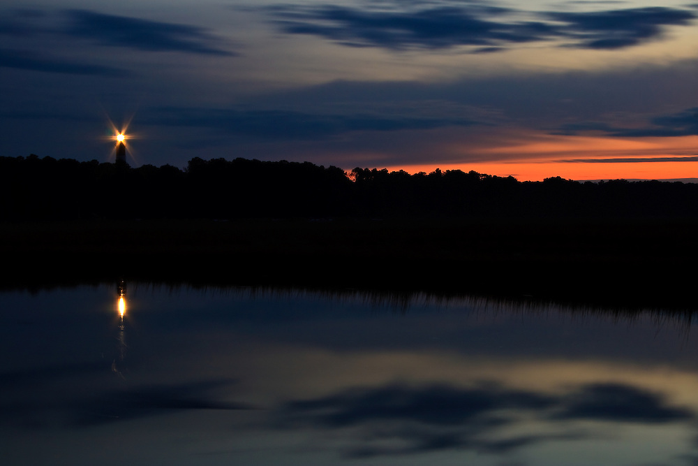 The Assateague Light House (rebuilt 1866) with the twilight sky reflected in the Assateague Channel, Chincoteague National Wildlife Refuge, Assateague Island, Virginia.