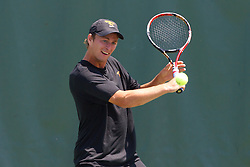May 24, 2011; Stanford, CA, USA;  Southern California Trojans number 2 singles player Jack Poldma hits a backhand against Virginia Cavaliers number 2 singles player Alex Domijan (not pictured) during the finals of the men's team 2011 NCAA Tennis Championships at the Taube Tennis Center.