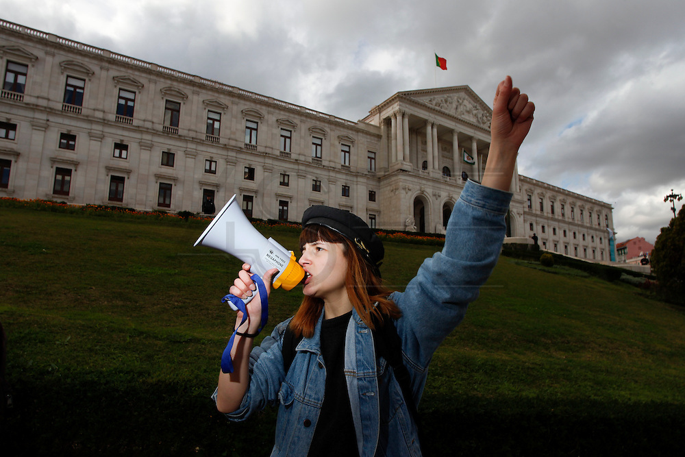 21 March 2013 - Lisbon, Portugal - A University student shout slogans in front of the Portuguese Parliament, during a demonstration today in center Lisbon against austerity measures in Education in order to achieve the goals set by the Troika (IMF, ECB, EC) for the Portuguese bailout package.<br />