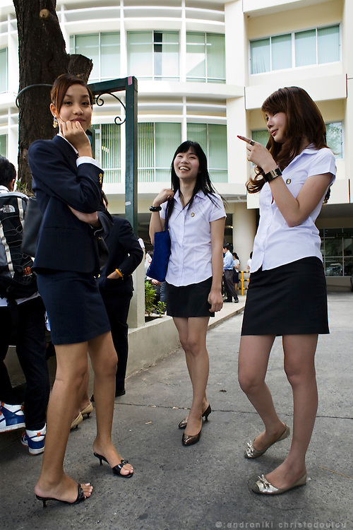 """Ladyboys Arttasit Tipsing (21) a catering student (middle) with Samathi Seangsuwan a hotel .business student (left) and Thipthantri Rujiranon (22) a comunication art student and winner of .the ladyboy beauty contest  """"Miss Tiffany Universe"""" in 2005, in the rest area of Suan Dusit .university. In Suan Dusit University in Bangkok, ladyboys feel free to be themselves by getting .dressed in girls' uniforms and behaving in a feminning way. The University's policy of accepting .them as equal to other students, has made it so popular that it now has about 100 transgender .students studuing in it's faculties."""