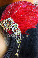 """Butterfly hairpiece/accessory<br /> one of a kind<br /> <br /> This can be worn as a hairpiece/ accessory that can also be clipped  to a blouse,pocket book,hat etc. <br /> <br /> Materials: butterfly photo,red colored  feathers,shells and swarovski crystal with barrette clip.<br /> <br /> size: 4 """" x 3 1/2"""" x 1/2""""<br /> <br /> price: $64.00<br /> <br /> <br /> + Giveback<br /> When you make a purchase from this site 7%  will be shared with a non-profit that focuses on making a positive difference in the world today.<br /> <br /> Buying art  + Making a difference = Art with Heart<br /> <br /> <br /> <br /> ©2019 All artwork is the property of STAR NIGRO.  Reproduction is strictly prohibited."""