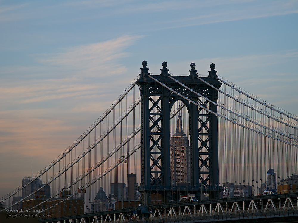 Manhattan Bridge and Empire State Building seen from Brooklyn Bridge, New York, NY, US
