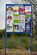 Nederland, Ubbergen, 4-11-2014 Verkiezingsaffiches voor de komende gemeenteraadsverkiezingen op 19 november. Herindeling, fusie, samengaan, samenvoeging van de gemeenten Groesbeek, Millingen aan de Rijn en Ubbergen plaats per 1 januari 2015. 19 November kiezen inwoners van deze gemeenten hun nieuwe gemeenteraad. Foto: Flip Franssen/Hollandse