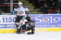 KELOWNA, CANADA - FEBRUARY 18: Myles Bell #29 of the Kelowna Rockets collides with Chad Robinson #17 of the Red Deer Rebels as the Red Deer Rebels visit the Kelowna Rockets on February 18, 2012 at Prospera Place in Kelowna, British Columbia, Canada (Photo by Marissa Baecker/Shoot the Breeze) *** Local Caption ***