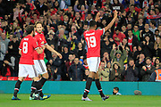 Manchester United striker Marcus Rashford (19) celebrates scoring a goal (2-0) with team-mates during the EFL Cup match between Manchester United and Burton Albion at Old Trafford, Manchester, England on 19 September 2017. Photo by Richard Holmes.
