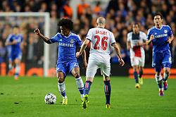 Chelsea Midfielder Willian (BRA) is challenged by PSG Defender Christophe Jallet (FRA) - Photo mandatory by-line: Rogan Thomson/JMP - 07966 386802 - 08/04/2014 - SPORT - FOOTBALL - Stamford Bridge, London - Chelsea v Paris Saint-Germain - UEFA Champions League Quarter-Final Second Leg.