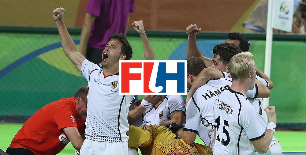 RIO DE JANEIRO, BRAZIL - AUGUST 14:  Germany celerbate after scoring the match winning last second goal during the Men's hockey quarter final match between the Germany and New Zealand on Day 9 of the Rio 2016 Olympic Games at the Olympic Hockey Centre on August 14, 2016 in Rio de Janeiro, Brazil.  (Photo by David Rogers/Getty Images)