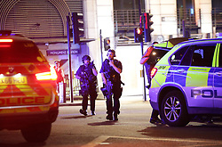 Armed police outside Monument station as police are responding to three incidents in the capital, amid reports that a vehicle collided with pedestrians on London Bridge, Scotland Yard said. Officers are dealing with reports of stabbings in Borough Market, where armed officers attended and shots were fired.They are also at an incident in the Vauxhall area.