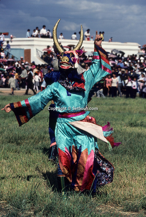 Mongolia. Buddhist Tsam dance with masks in dalanzadgad (Gobi desert)