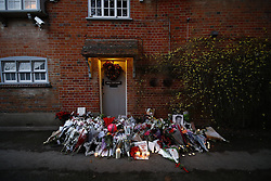 © Licensed to London News Pictures. 26/12/2016. Goring-, UK. Tributes are left at the door of George Michael's Oxfordshire home. Pop superstar George Michael died on Christmas day at his Oxfordshire home on the River Thames aged 53. Photo credit: Peter Macdiarmid/LNP