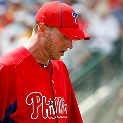 March 20, 2012; Sarasota, FL, USA; Philadelphia Phillies starting pitcher Roy Halladay (34) against the Baltimore Orioles during a spring training game at Ed Smith Stadium.  Mandatory Credit: Derick E. Hingle-US PRESSWIRE