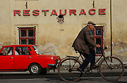 Town of Doksany: traffic in front of a restaurant. Czech Republic.