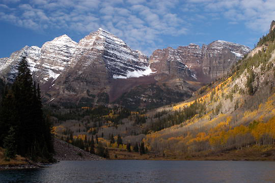 Maroon Lake at Maroon Bells Snowmass Wilderness Area during fall colors. Near Apsen, Colorado. Aspens are bright yellow. Fall.