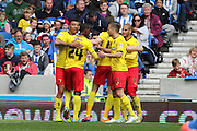 Watford's Troy Deeney celebrates after scoring during the Sky Bet Championship match between Brighton and Hove Albion and Watford at the American Express Community Stadium, Brighton and Hove, England on 25 April 2015. Photo by Geoff Penn.