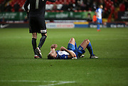 Blackburn Rovers striker, Jordan Rhodes (11) went down after receiving a knock to his head during the Sky Bet Championship match between Charlton Athletic and Blackburn Rovers at The Valley, London, England on 23 January 2016. Photo by Matthew Redman.