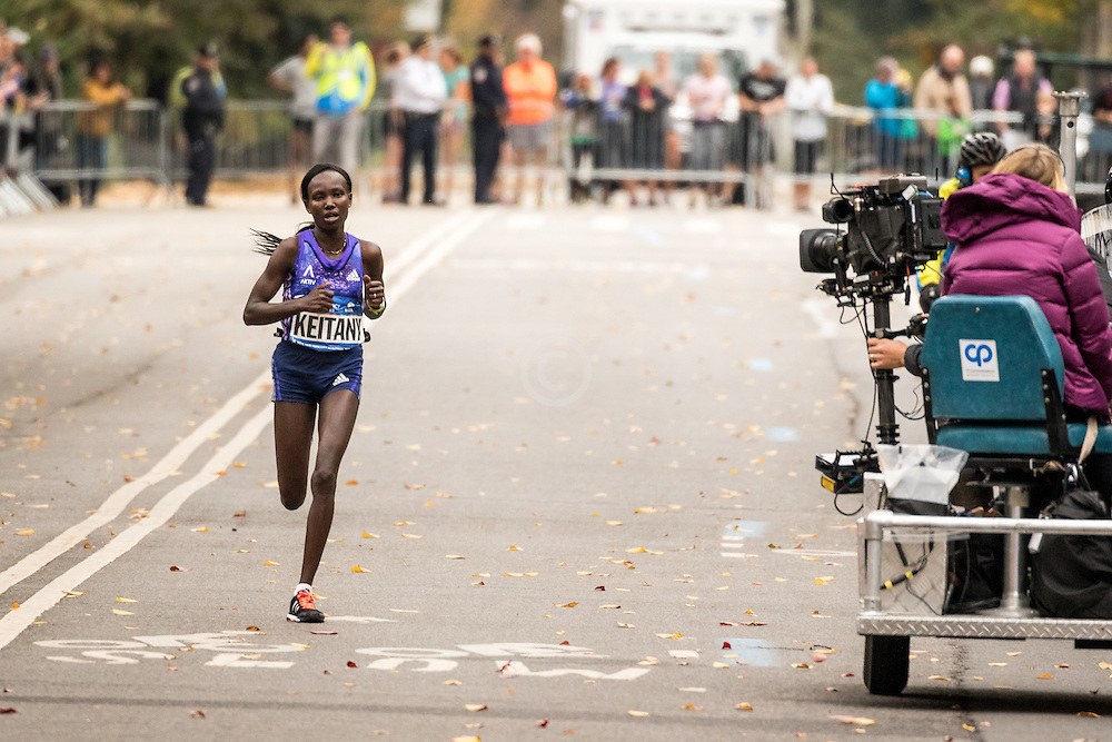 Mary Keitany, Kenya, all alone on Fifth Avenue in Manhattan near mile 23