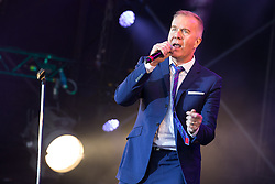 © Licensed to London News Pictures . 09/08/2015 . Siddington , UK . MARTIN FRY of ABC performs . The Rewind Festival of 1980s music , fashion and culture at Capesthorne Hall in Macclesfield . Photo credit: Joel Goodman/LNP