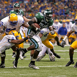 Sep 26, 2009; New Orleans, LA, USA;  Tulane Green Wave running back Andre Anderson (32) runs through McNesse State Cowboys defenders Darrell Jenkins (9) and Damion Aultman (55) and Seth Thomas (33) for a touchdown at the Louisiana Superdome. Tulane defeated McNeese State 42-32. Mandatory Credit: Derick E. Hingle-US PRESSWIRE