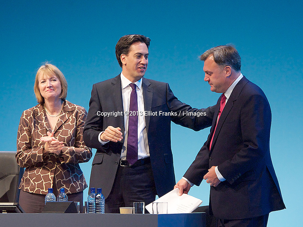 Labour Party Conference.<br /> Labour party deputy leader Harriet Harman (L) Labour Party leader Ed Miliband (centre) applauds Shadow Chancellor Ed Balls after he addressed the Labour Annual Conference at the Brighton Conference Centre, Brighton, United Kingdom. Monday, 23rd September 2013. Picture by Elliot Franks / i-Images