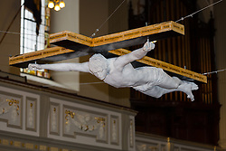 "© Licensed to London News Pictures. 19/02/2015. London, UK. A lifesize marble crucifixion sculpture of Pete Doherty, called ""For Pete's Sake"", is unveiled at St. Marylebone Parish Church in London and seen suspended above the aisle of the 200-year-old church. The life-size sculpture was made in 2008 as a collaboration between Pete Doherty and artist, Nick Reynolds. This is the first time the sculpture has been publically displayed and it is part of the exhibition in aid of a fund to help find Tom Moore, who went missing in 2003 called Stations of the Cross, which runs until 17th March and shows other works that make reference to the Passion of Christ. Photo credit : Vickie Flores/LNP"