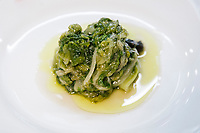 NAPLES, ITALY - 4 JANUARY 2019: Endives with capers and olives are seen here at Janarius, a restaurant in Naples, Italy, on January 4th 2019.<br /> <br /> Janarius is a typical Neapolitan gourmet restaurant and shop founded by Francesco Andoli in September 2018 in via Duomo, in front of the Naples's Duomo and treasure of Saint Janarius.
