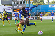 Jodi Jones takes down Jabo Ibehre with no penalty awarded during the Sky Bet League 2 match between Carlisle United and Dagenham and Redbridge at Brunton Park, Carlisle, England on 12 September 2015. Photo by Craig McAllister.