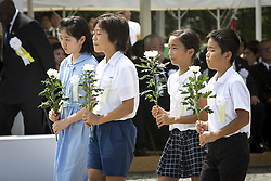 August 9, 2016 - Nagasaki, Nagasaki Prefecture, Japan - NAGASAKI, JAPAN - AUGUST 9 : Youth representatives lays flowers to the atomic bomb victims in front of the Peace Statue in Nagasaki Peace Park, Nagasaki, southern Japan, Tuesday, August 9, 2016. Japan marked the 71st anniversary of the atomic bombing on Nagasaki. On August 9, 1945, during World War II, the United States dropped the second Atomic bomb on Nagasaki city, killing an estimated 40,000 people which ended World War II. (Credit Image: © Richard Atrero De Guzman/NurPhoto via ZUMA Press)