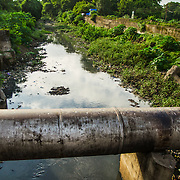 CAPTION: River Khan, now reduced to a stinking drain, runs adjacent to the Indore Zoo. Its water is pumped in by the well at the zoo, and is then treated at the plant. LOCATION: Outside Indore Zoo, Indore, Madhya Pradesh, India. INDIVIDUAL(S) PHOTOGRAPHED: N/A.
