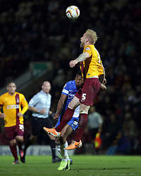 Peterborough United's Britt Assombalonga in action with Bradford City's Andrew Davies  - Photo mandatory by-line: Joe Dent/JMP - Mobile: 07966 386802 18/04/2014 - SPORT - FOOTBALL - Bradford - Valley Parade - Bradford City v Peterborough United - Sky Bet League One