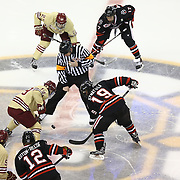 The face-off during The Beanpot Championship Game at TD Garden on February 10, 2014 in Boston, Massachusetts. (Photo by Elan Kawesch)