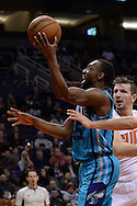 Jan 6, 2016; Phoenix, AZ, USA; Charlotte Hornets guard Kemba Walker (15) drives the ball against the Phoenix Suns at Talking Stick Resort Arena. The Phoenix Suns defeated the Charlotte Hornets 111-102. Mandatory Credit: Jennifer Stewart-USA TODAY Sports
